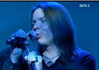 Norwegian Rock Star Henrik Johnsen from Pluto and the Planets wearing his black diode amulet on NRK-TV performance
